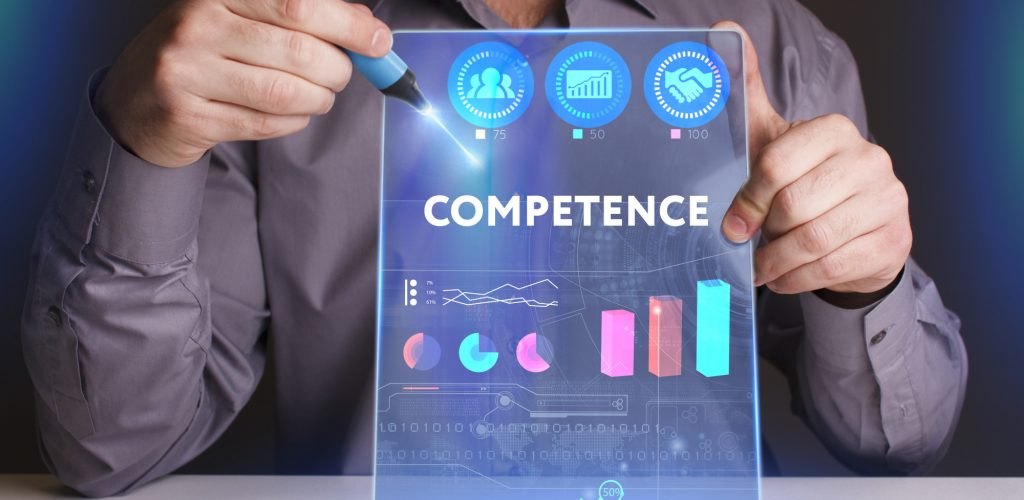 Business, Technology, Internet and network concept. Young businessman working on a virtual screen of the future and sees the inscription: Competence